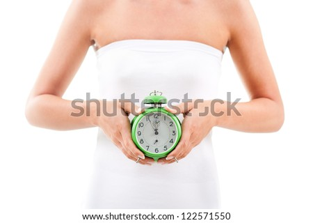 Woman holding clock on her belly,Biological clock