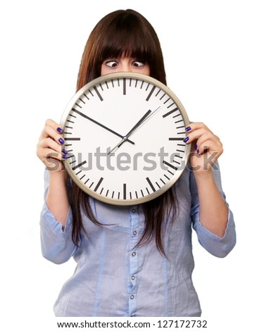 Woman Holding Clock With Squinted Eyes Isolated On white Background