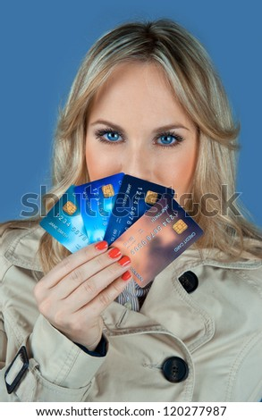 woman holding collection of credit cards