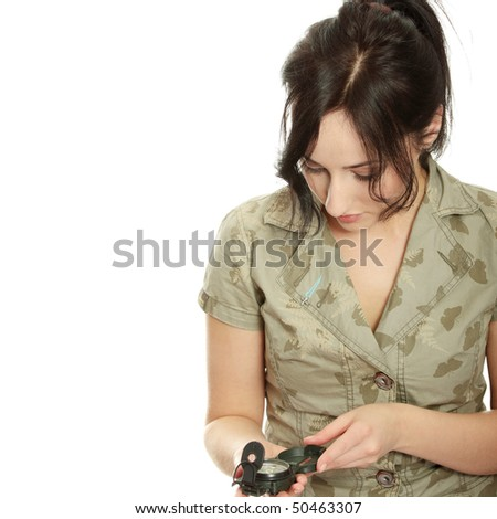 Woman holding compass - stock photo
