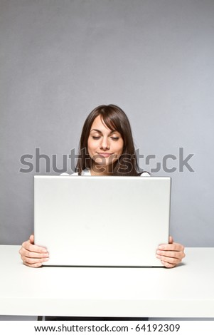 woman holding computer