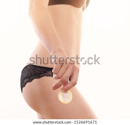 Woman holding condom Close up . Sexual relationship, Contraception, Prevention of sexually transmitted diseases. #1526691671