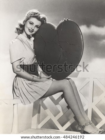 woman holding cracked heart
