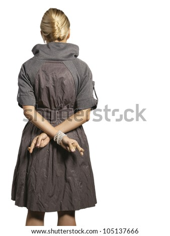woman holding cross fingers behind her back
