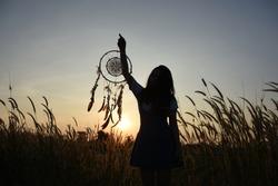 Woman holding dream catcher