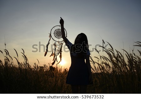 Woman holding dream catcher