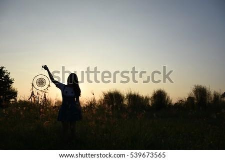 Woman holding dream catcher #539673565