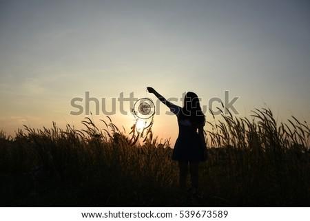 Woman holding dream catcher #539673589