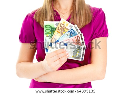 Woman holding euro in her hands isolated on white