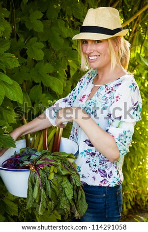 Woman holding fresh vegetables just picked from the garden