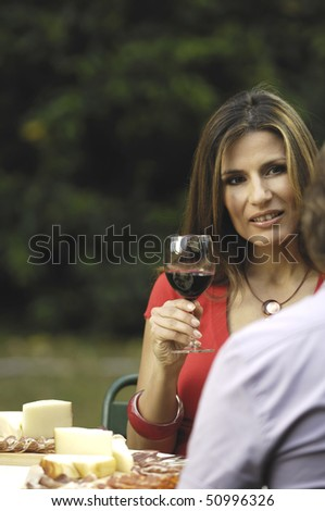 woman holding glass outdoor