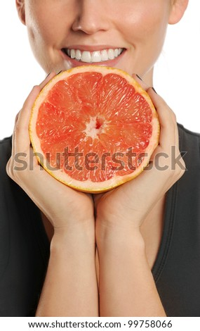 Woman holding grapefruit in hands. Isolated on white - stock photo