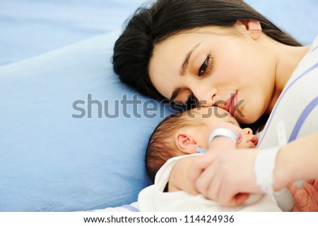 Woman holding her 2 days old newborn baby