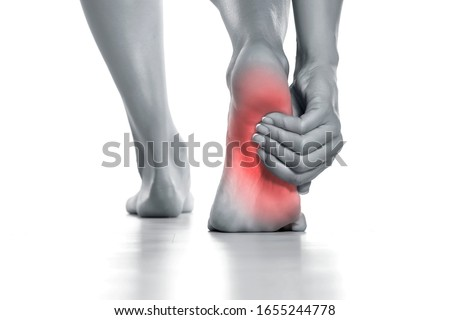 woman holding her painful foot on white background Photo stock ©