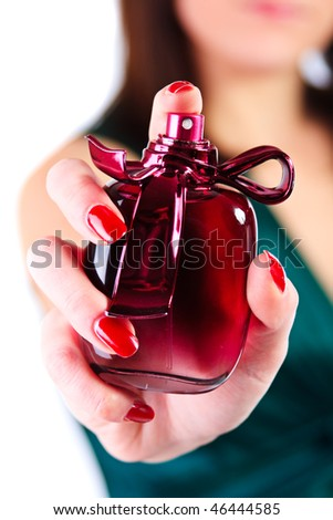 Woman holding in her hand perfume