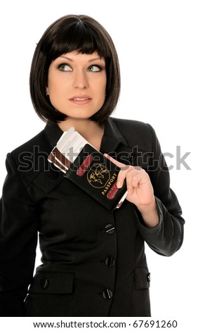 Woman holding in the hand passport and airline tickets for business trip