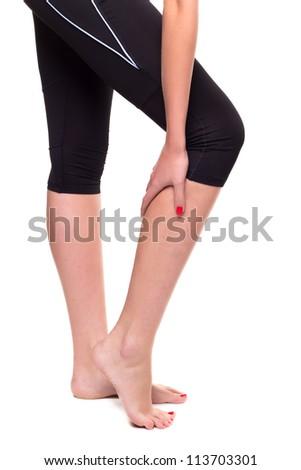 Woman holding leg, isolated on white