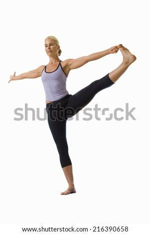 woman holding leg out and balancing, cut out