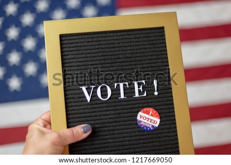 Woman holding letterboard sign with the word Vote Stock fotó ©