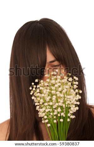Woman holding lily of the valley in the hand
