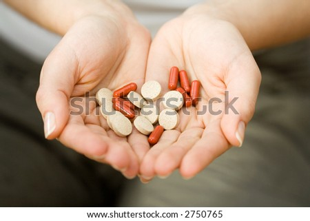 Woman holding medicines in her hands