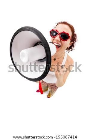 Woman holding megaphone and yelling, fisheye lens, studio shot