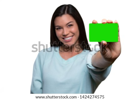 Woman holding mockup credit card or similar shaped card, smiling cheerful, ethnically ambiguous, closeup focus on hand