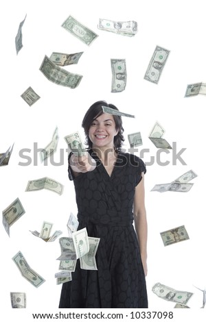 Woman holding money while currency rains down around her.