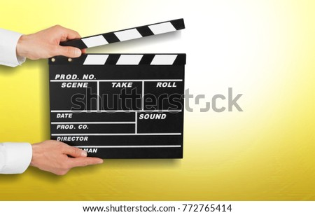 woman holding movie clapper #772765414