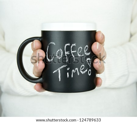 woman holding mug of coffee with coffee time text in chalk