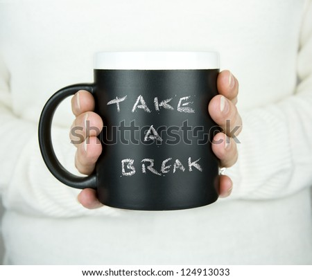 woman holding mug of drink with take a break text in chalk