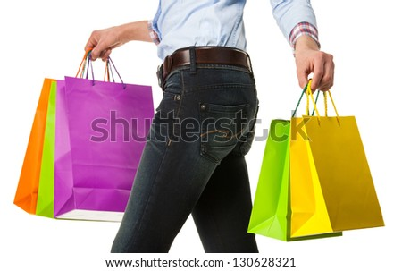 Woman holding multicolored shopping paper bags - closeup shot on white background