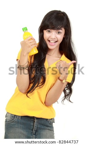 Woman holding orange juice smiling showing orange juice product with thumb up sign. isolated over white background