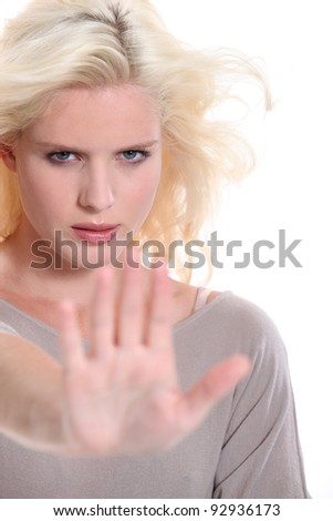 Woman holding out her hand in a stop signal