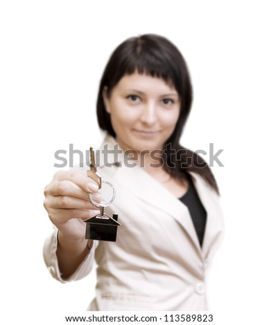 Woman holding out house keys on a silver house-shaped key chain