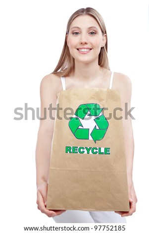 woman holding paper recycling bag
