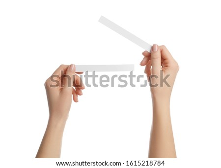 Woman holding perfume testing strips on white background, closeup of hands Photo stock ©