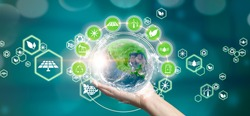 Woman holding planet earth with recycling symbols and green planet. Eco concept, ecology, clean energy and environment. Elements of this image furnished by NASA