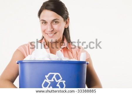 woman holding recycling bin - stock photo