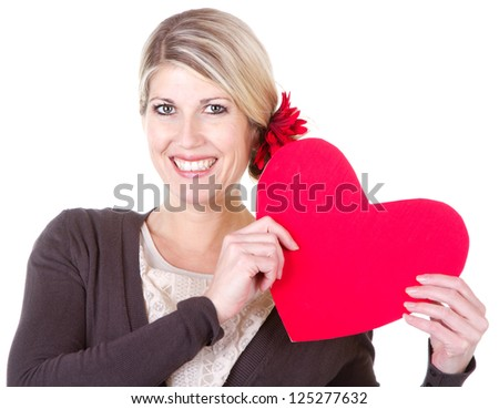 woman holding red heart close-up isolated on white