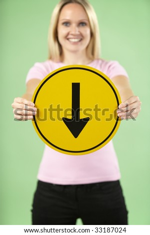 Woman Holding Road Traffic Sign