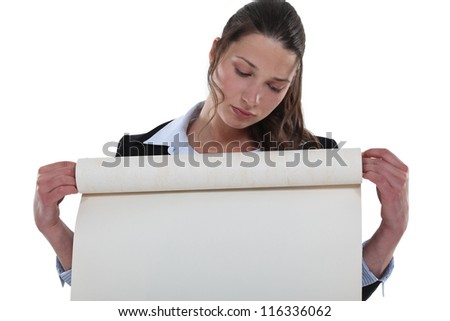 Woman holding roll of flip chart paper