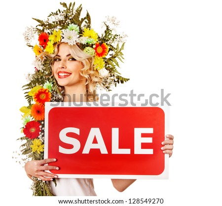 Woman holding sale banner and flower. Isolated.