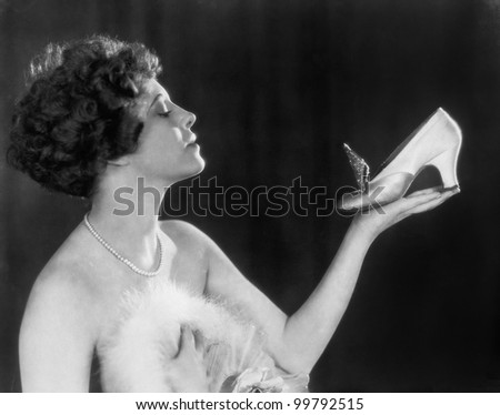 Woman holding shoe - stock photo