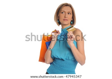 Woman holding shopping bags and credit card isolated on white