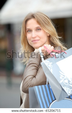 Woman holding shopping bags in town