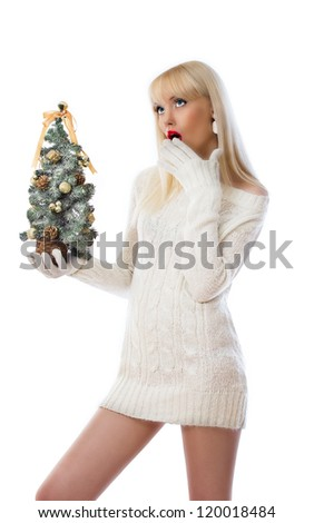 Woman holding small christmas tree and looking up at copy space on white background
