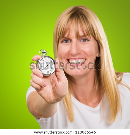 Woman Holding Stopwatch against a green background
