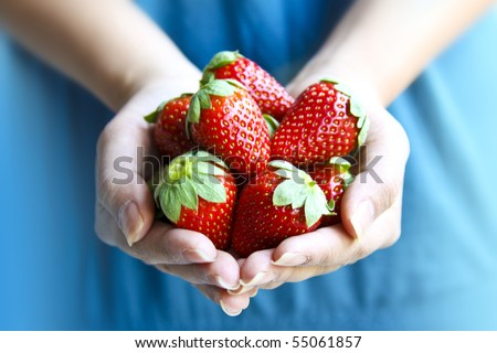 Woman Holding Strawberries
