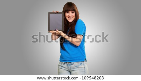Woman Holding Tablet Isolated On Gray Background